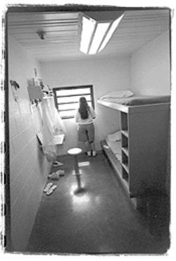 A girl in her cell at Black Canyon School.