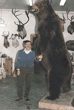 Tony Fabriger and his bear, in 1986, at the taxidermist shop.