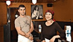 "Waynes' world: Lola Tapas' owners Daniel and Felicia Ruiz Wayne; their daughter Paloma (a.k.a. ""Lola"") is pictured behind them."