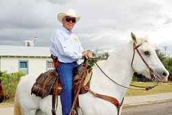 The rural Arizona sheriff on a white horse.