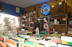 Michael Pawlicki works behind the counter at Eastside Records, as he's done for most of the past 25 years.