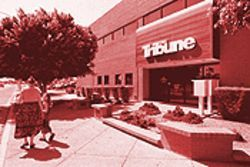 Freedom Communications now owns the East Valley Tribune and eight other Arizona newspapers, including the Scottsdale Tribune.