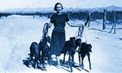 Rachael Ellis walks her family's greyhounds on their desert property in Scottsdale, in the 1930s.