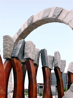 Landmark, a stone-and-iron sculpture by Ilan Averbuch sits at the Metro light-rail stop at Central and Camelback.