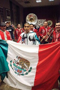 "The group Banda La Llegadora rallies  fight fans with a Mexican ballad as Alexis ""Beaver"" Santiago heads to the ring."