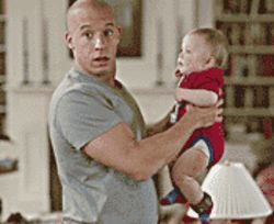Charged with protecting a group of kids, Vin Diesel warms up to the baby in his care (played by twins Bo and Luke Vink) in The Pacifier.