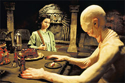 Fractured fairy tale: Ofelia (Ivana Baquero) encounters the Pale Man (Doug Jones) in Pan's Labyrinth.