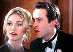 Julia Stiles and Jason Lee play two thirds of a love triangle in A Guy Thing.
