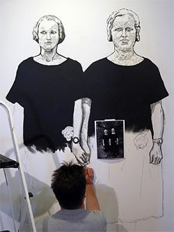 Artist Jon Haddock works on Martha + Mary, a wall painting inspired by a picture taken by German photographer August Sander.