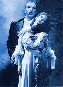 Brad Little and Rebecca Pitcher in The Phantom of the Opera.