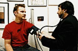 Feeding frenzy: Morgan Spurlock (left) is examined by a doctor after his binge diet in Super Size Me.