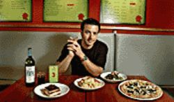 Saucy fella: Sauce chef Christopher Cristiano likes his pizza dry and his vino in a highball glass.
