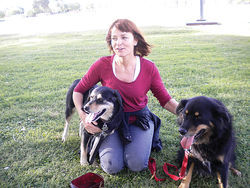 Raven's pal Kelly Crittenden in the park with her dogs Juno and Angelo.
