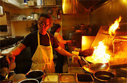 It's getting hot in here: Andy Tran cooks up a fiery dish.