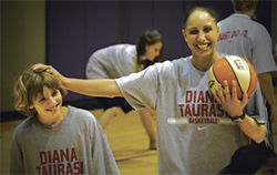 Taurasi clowns around with one of the students at her basketball camp.