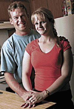 Alishia Hight (right), with her husband Joe, turned her life around through treatment.