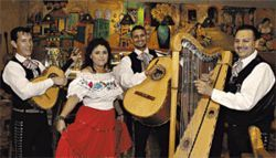Latino vibe: A dolled-up waitress takes time out to pose with Mariachi o Trio Alegria at Tradiciones.