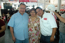 Miguel Angel Lopez Velasco, a.k.a Milo Vela (left); his wife, Agustina Solana; and son, Miguel Angel Lopez Solana. The photo was taken at an anniversary party for employees of the newspaper Notiver in Veracruz. Note that he is wearing a shirt with the newspaper logo on it.