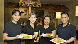 The Thai Hut crew, including Teera Jattuchai (right), serves up tasty ethnic specialties.