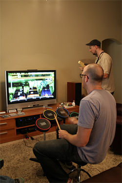 They're a real band, too: The Minibosses play some Rock Band.