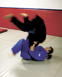 Farrow executes a judo throw.
