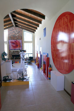 Looking from the foyer of Seeger's home/museum into his great room; along the walls are artworks he has created over the years.
