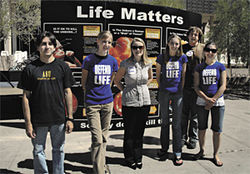 Emily Mitchell and ASU Students for Life set up a display outside Memorial Union.