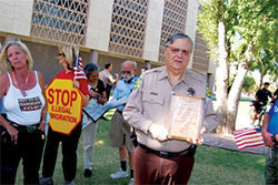 Arpaio receives a plaque from nativists, including U.S.A. member Barb Heller (left)
