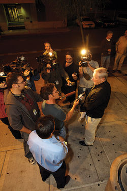 Lacey with reporters after his release from jail.