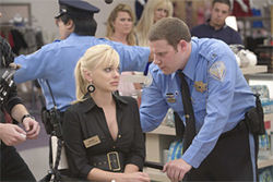 Made for each other: Anna Faris and Seth Rogen play cute-pathetic and cute-creepy in Observe and Report.