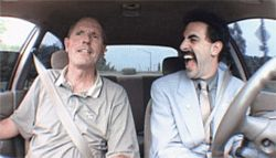 Culture shock: Sacha Baron Cohen (right) gets a driving lesson from an auto salesman in Borat: Cultural Learnings of America for Make Benefit Glorious Nation of Kazakhstan.