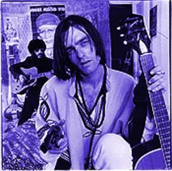 Sinister poseur or undiscovered rock genius? The Brian Jonestown Massacre's Anton Newcombe wielding gun and guitar.