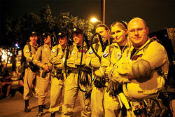 The Arizona Ghostbusters at a First Friday art walk event in downtown Phoenix, posing with a young fan, fending off zombies, and participating in a charity walk.