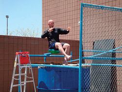 Babeu in a dunk tank to raise money for a Sheriff's Office Benevolent Fund.