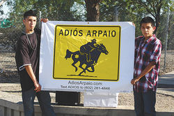 Volunteers with the Adios Arpaio movement, which has registered