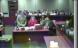 Lisa Randall (in jail clothes) and her supporters listen as her attorney, David Cantor, speaks on her behalf in an early 2008 hearing.