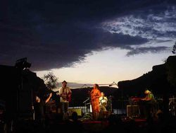 Sunset sounds: The Sugar Thieves perform at last year's Apache Lake Music Festival.