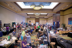 The 2014 International UFO Congress conference hall at the Radisson Fort McDowell Resort and Casino was packed with UFO information and vendors, including some who sold secret patches  and crystals.
