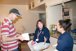 Russ Jefferson at his apartment with Community Bridges navigators Jeanne Allen (middle) and Liz DaCosta.
