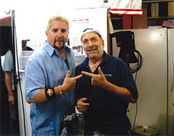 Diners, Drive-ins and Dives host Guy Fieri (left) with Phoenix cellist and restaurateur Richard Bock.