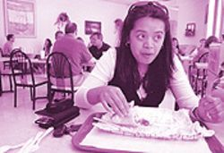 Michelle Mamaril eats a beef kebab at ZakeE restaurant.