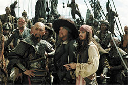 Plundering your wallets: Chow Yun-fat, Geoffrey Rush, and Johnny Depp mince about in Pirates of the Caribbean: At World?s End.