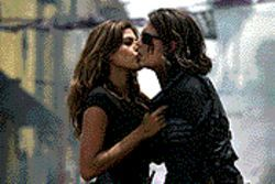 Depp perception: Johnny Depp (right, with Eva Mendes) almost single-handedly redeems Once Upon a Time in Mexico.