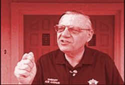Sheriff Joe Arpaio speaks to the media in front of his home last July about an alleged attempt on his life.