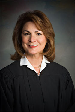 Presiding County Judge Barbara Mundell has battled Andrew Thomas since 2005.
