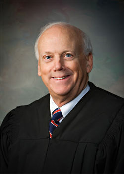 Judge Ed Burke rejected efforts by Thomas to get a senior judge booted off all criminal cases.
