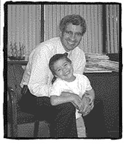 Dr. Michael Teodori with heart patient Xzavion Gonzales, July 2002.