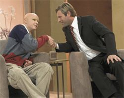 Thank you for getting cancer: Eric Haberman (left) gets spun by Aaron Eckhart.