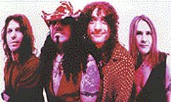 He's unbe-weave-able: Kevin DuBrow (second from right) resurrects Quiet Riot.