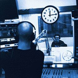 Jason Stone, foreground, exchanges repartee with his co-host, Jay Biaz, during State of the Skate.